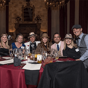 Charlotte Murder Mystery party guests at the table