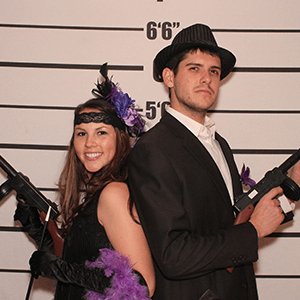 Charlotte Murder Mystery party guests pose for mugshots